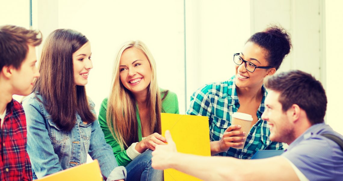 education concept - students communicating and laughing at school